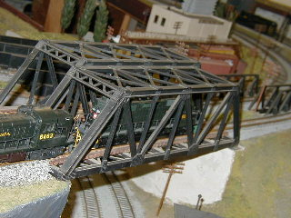 The freight crosses another bridge.